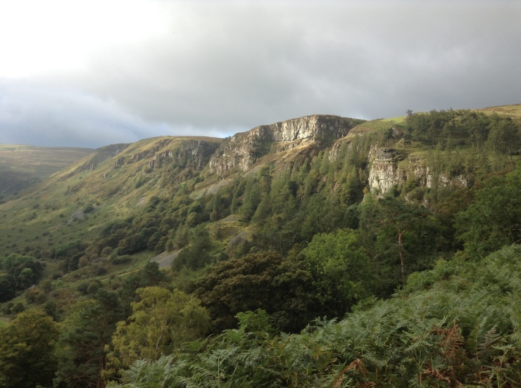 Sun on the cliffs seen from the top of the falls at Pistyll Rhaeadr
