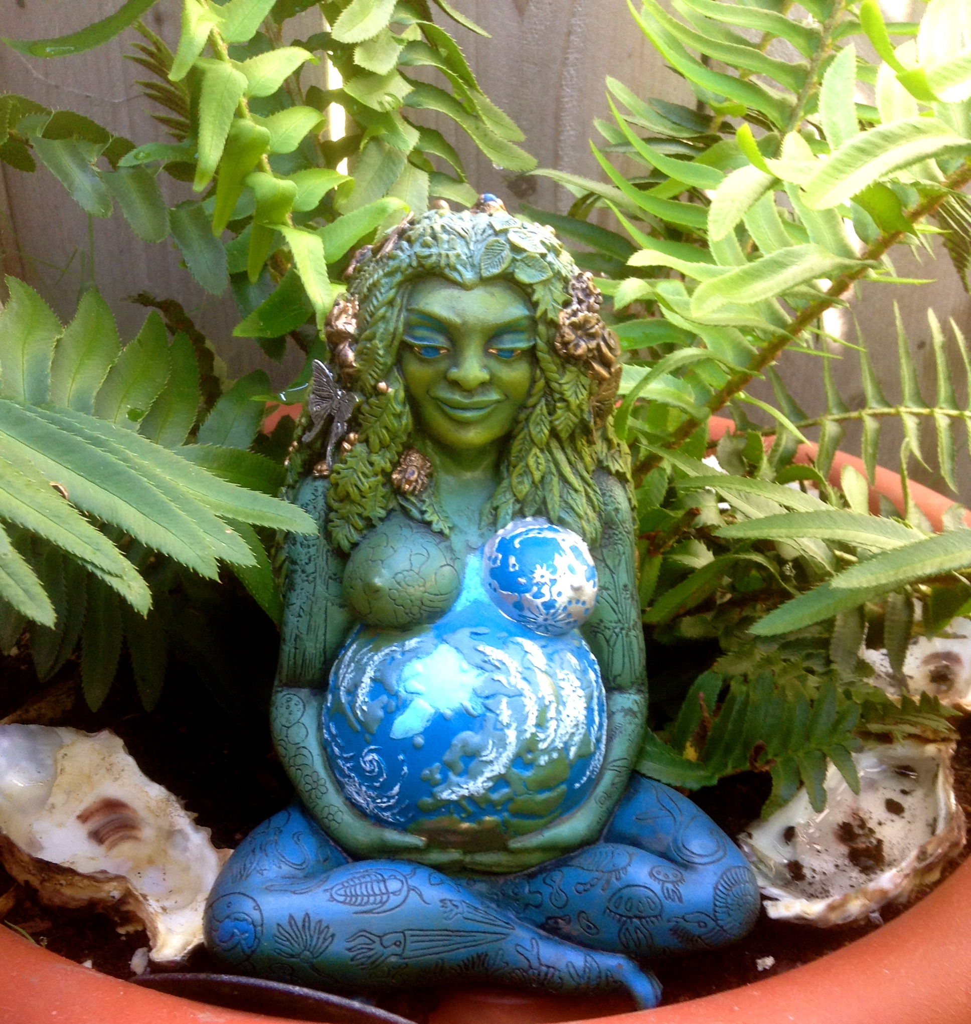 Gaia statue among the ferns