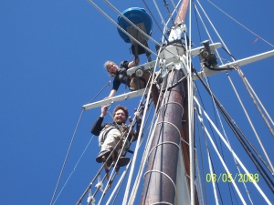 Crew members in the rigging of a tall ship